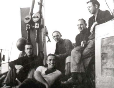 Photograph Chico's wartime crew, with Lewis gun in background