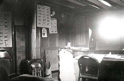 Photograph of wartime saloon, complete with aircraft recognition charts